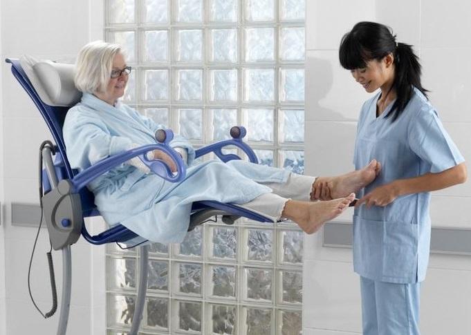 Arjo Carino height adjustable shower chair