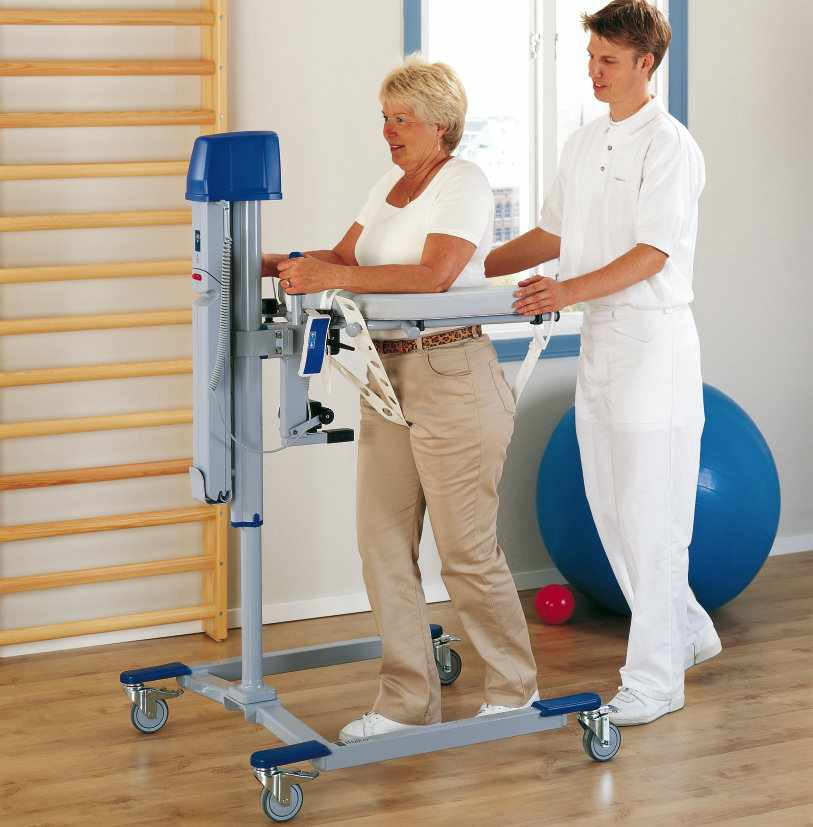 Arjo electric lift walker with client