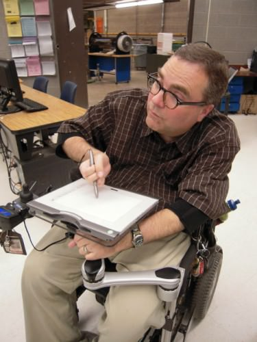 Mount'n Mover dual arm wheelchair attachment with user