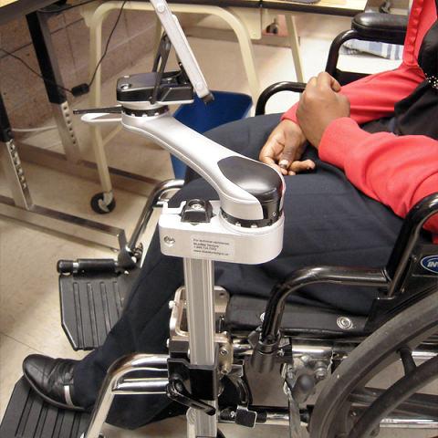 Single arm wheelchair attachment